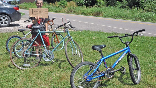 Peyton Davis, an enterprising eleven year old, spends time going to flea markets to buy bikes, weed eaters and other small engine items. He then brings them home, fixes them and puts them up for sale in his front yard on Mechanicsburg Road outside Wooster