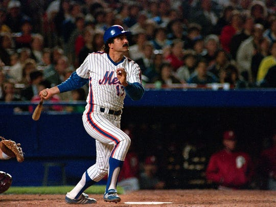 Keith Hernandez hits a home run during a 1989 game.