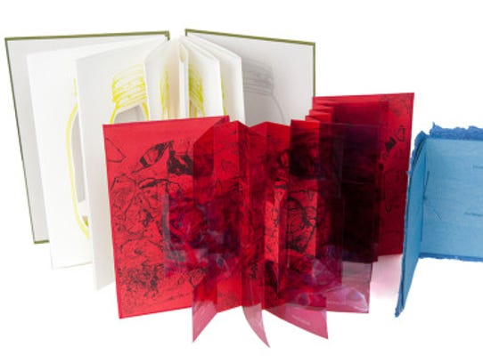A 2013 trio of hand-bound books by Mirabelle Jones.