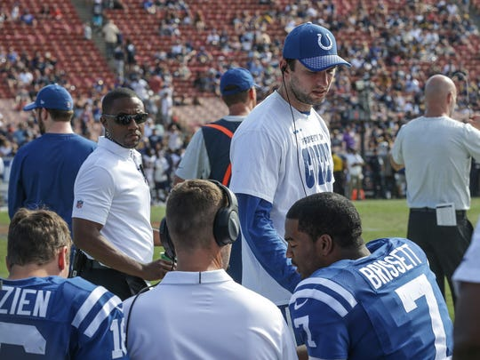 Indianapolis Colts quarterback Jacoby Brissett (7) talks with Colts quarterbacks coach Brian Schottenheimer in the fourth quarter against the Los Angeles Rams at Los Angeles Memorial Coliseum in Los Angeles on Sunday, Sept. 10, 2017.
