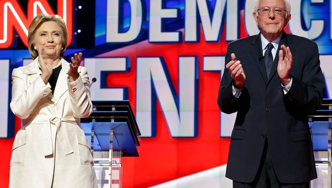 Democratic presidential candidates Sen. Bernie Sanders and Hillary Clinton attend a Democratic presidential primary debate in New York on April 14. The candidates on Friday scheduled appearances in Wilmington in advance of the Tuesday primary.