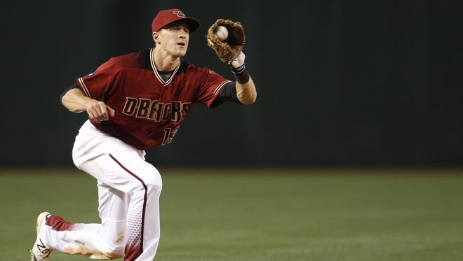 Arizona Diamondbacks' Nick Ahmed makes a play at short as the Arizona Diamondbacks face off against the Pittsburgh Pirates on Sunday, April 24, 2016, at Chase Field in Phoenix, Ariz. Pirates beat the Dbacks 12-10 in 13 innings.