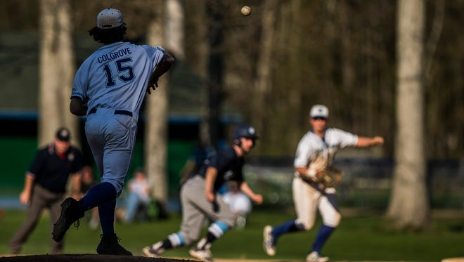Colchester pitcher Tom Colgrove tries to pick off MMU's #13 Josh Springer at first base during their baseball game Wednesday night, May 9, 2018, against Colchester. MMU won, 8-4.