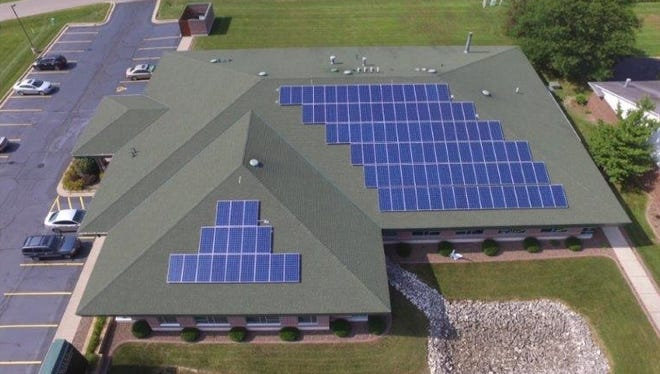 Jeff Tjugum's American Family Insurance office in Wales recently installed 2,295 square feet of solar panels on the roof.