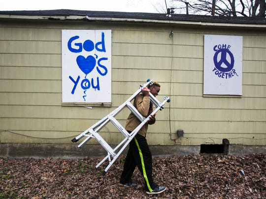 March 16, 2017 - Kingsbury High School graduate Justin McGluen 18, carries a ladder away after he and other volunteers boarded up a vacant house on Manhattan Ave. in the Douglass neighborhood on Thursday morning. About 60 students from Douglass and Kingsbury high schools, along with volunteers from other youth groups spent most of their Spring Break fighting blight in North Memphis.