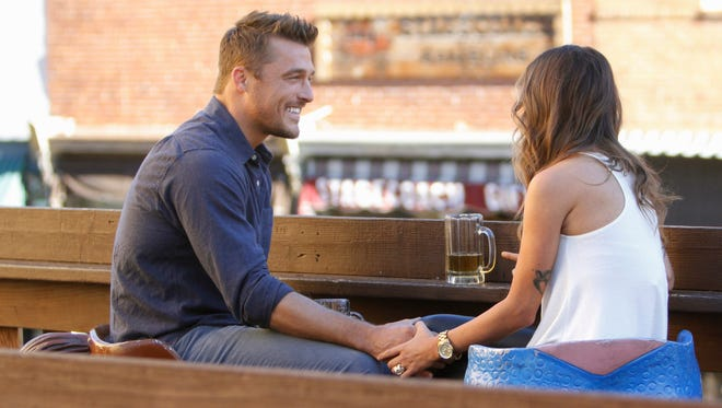 """Bachelor Chris Soules and contestant Kaitlyn share a sweet moment on ABC's """"The Bachelor,"""" on Monday, February 9, 2015."""