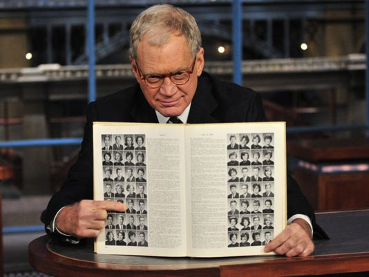 635859542556157065-Letterman-and-his-yearbook.jpg