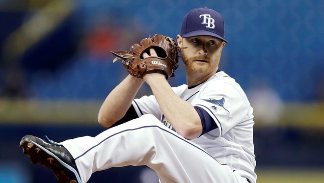 FILE - In this Sept. 4, 2017, file photo, Tampa Bay Rays' Alex Cobb goes into his windup during the first inning of a baseball game against the Minnesota Twins in St. Petersburg, Fla.  Cobb, a free agent, and the Baltimore Orioles have finalized a four-year contract. The 30-year-old righty was 12-10 with a 3.66 ERA in 29 starts for Tampa Bay last season. (AP Photo/Chris O'Meara, File)