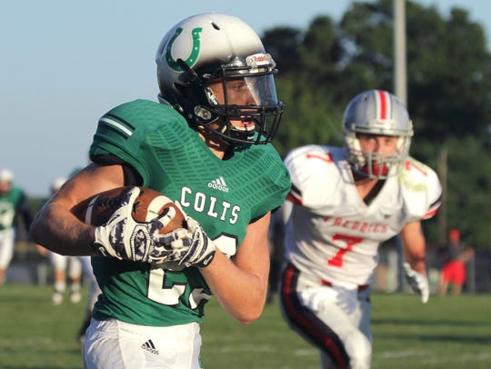 Clear Fork's Bryce Lyon runs the ball to score a touchdown