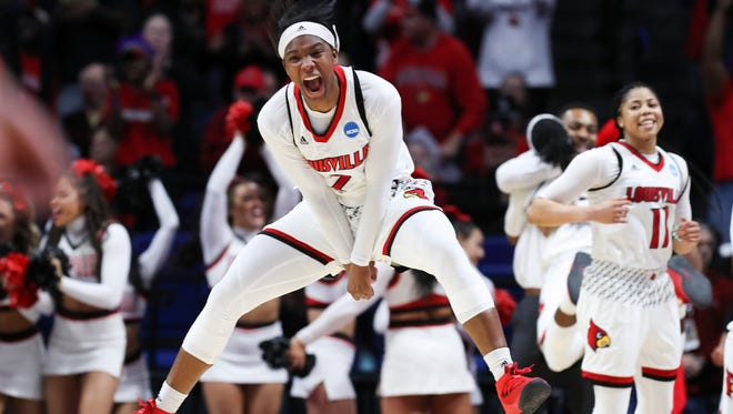 Louisville's Myisha Hines-Allen (2) jumps for joy during the closing seconds of their win over Oregon State during their NCAA Elite 8 matchup at Rupp Arena in Lexington.    Mar. 25, 2018