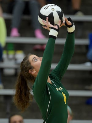 Northeastern's Sasha Middleton sets the ball against Hagerstown Thursday, Oct. 20, 2016 during a volleyball sectional match at Lincoln High School in Cambridge City.