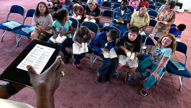 Richard Darden leads a Bible quiz May 30, 2018 at Shining Star Fellowship church.