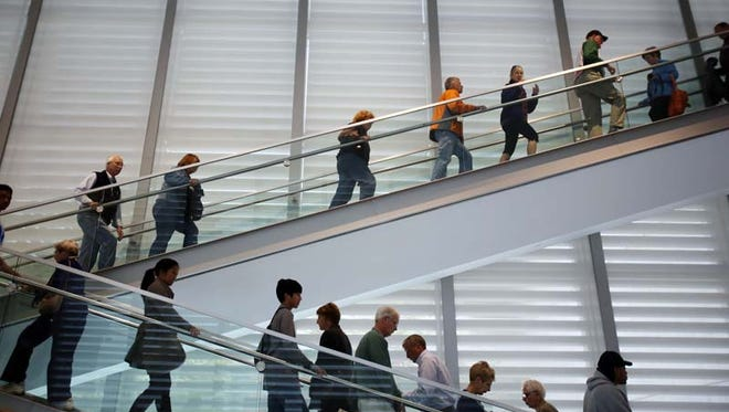 Artprize 2014 attendees move throughout the Grand Rapids Museum.