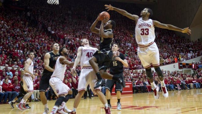 Jeremy Hollowell of Indiana tries to block a shot by Terone Johnson of Purdue last season.