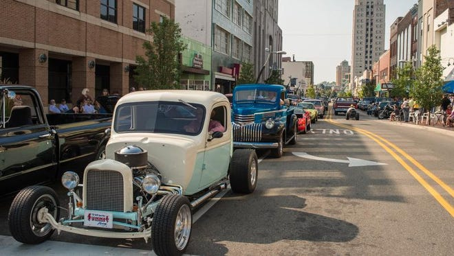 Cars cruise along Michigan Ave at the 2014 Cruise the Gut in downtown Battle Creek.