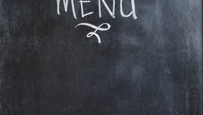 Menu wording with chalk on blackboard