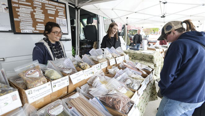 People check out Pappardelle's noodles for sale Saturday, April 18, 2015 at the Drake Road Farmers Market in Fort Collins, CO.