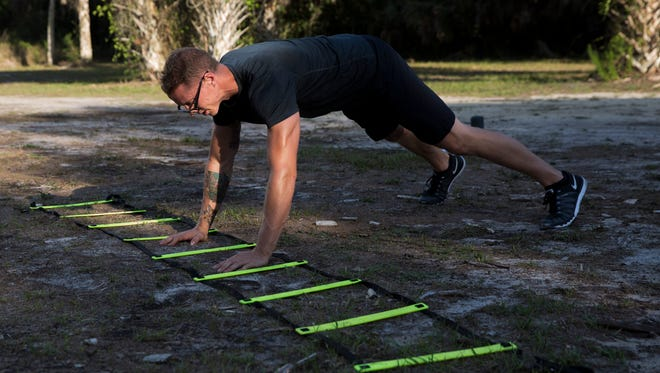 """Personal trainer Johnathan Blevins has taken years of fitness experience and created an engaging """"Boot Camp"""" style program for those seeking a different type of exercise at Koreshan State Historic Site Monday, May 22, 2017 in Fort Myers, Fla. Blevins daily routines change from day to day but usually feature plenty of cardio."""