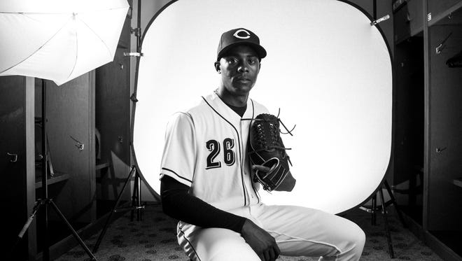 Cincinnati Reds relief pitcher Raisel Iglesias (26) poses during picture day at the Cincinnati Reds training complex in Goodyear, Ariz., on Tuesday, Feb. 20, 2018.