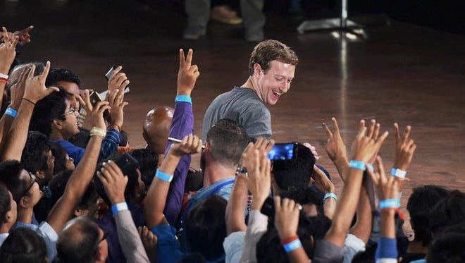 Facebook's CEO Mark Zuckerberg interacts with technology students in a town hall-style meeting in New Delhi, India, Wednesday, Oct. 28, 2015. Zuckerberg is his second visit to India this year.