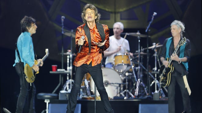 "The Rolling Stones' Mick Jagger takes center stage during their ""Zip Code"" tour at Ralph Wilson Stadium in Orchard Park on Saturday."