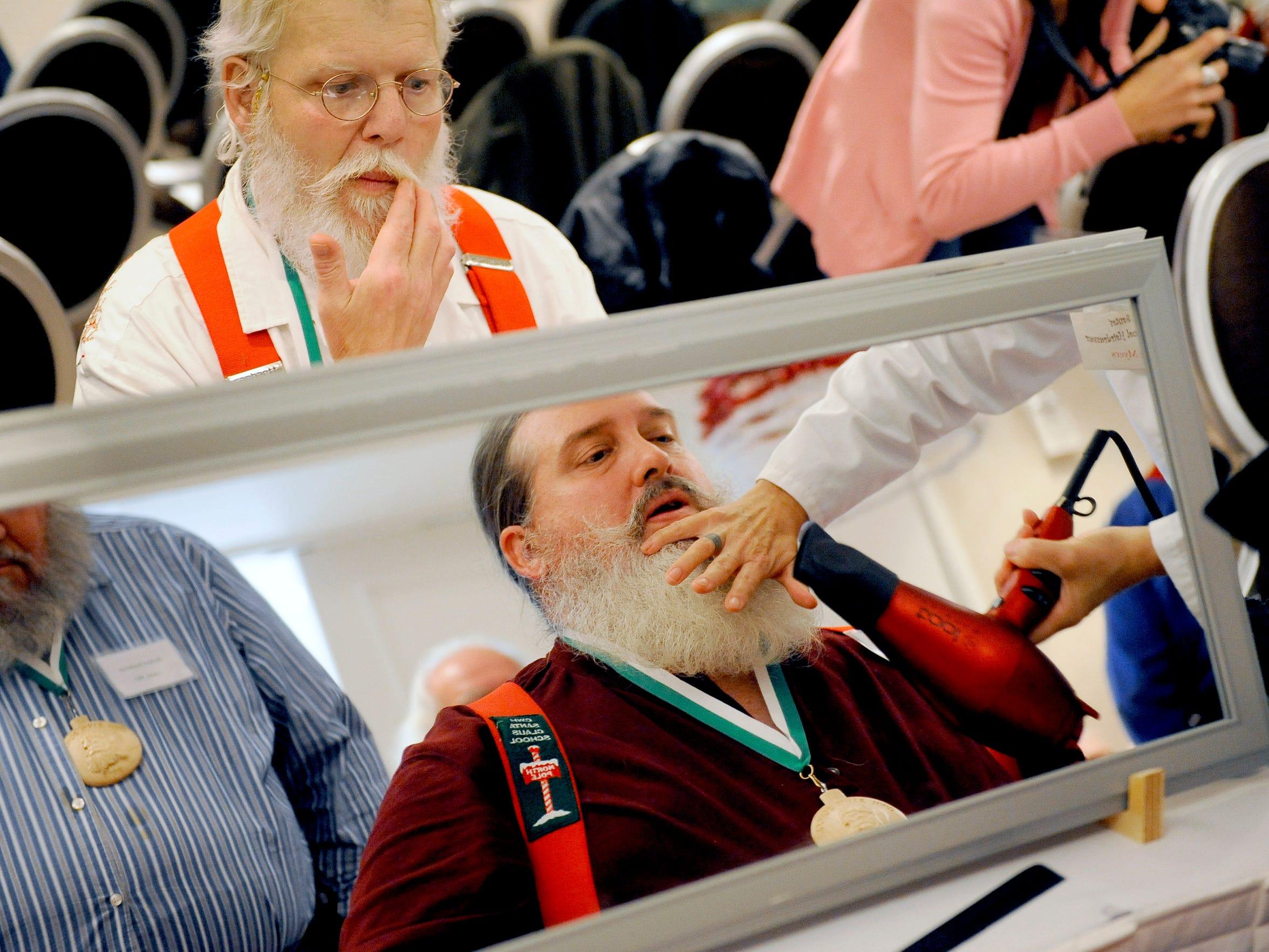 Santas get grooming tips and beard work at the Santa