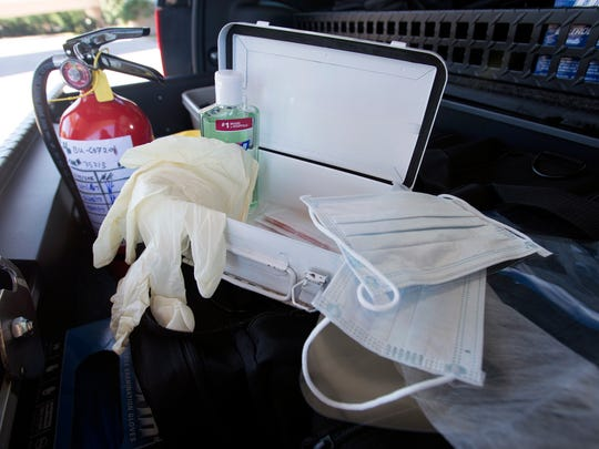 First aid kits in Pensacola Police Department vehicles include rubber gloves, face masks with eye shields, hand sanitizer, adhesive bandages and a fire extinguisher. The items are pictured on Thursday, April 6, 2017.