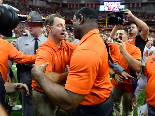 Clemson coach Dabo Swinney, left, congratulates Syracuse