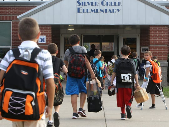 Students arrive at Silver Creek Elementary. West Clark