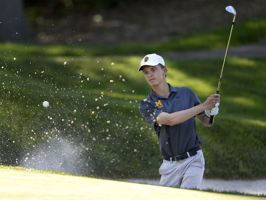 McQuaid's Jack Bailey blasts out of a greenside bunker