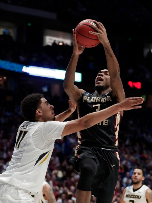 Florida State guard Trent Forrest (3) goes to the basket against Missouri forward Jontay Porter (11) in the first half of a first-round game of the NCAA college basketball tournament in Nashville, Tenn., Friday, March 16, 2018. (AP Photo/Mark Humphrey)