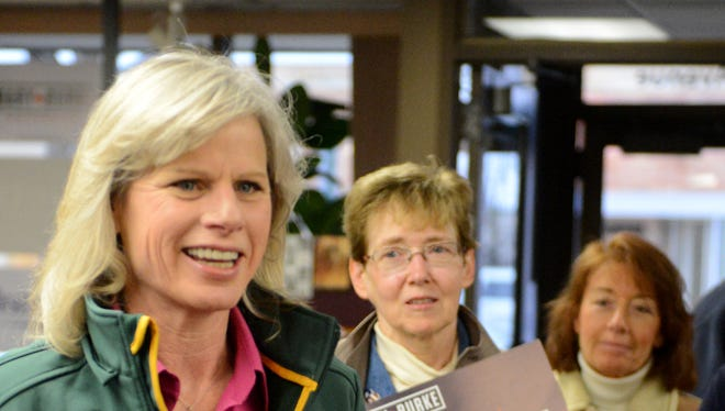 Democratic gubernatorial candidate Mary Burke, left, makes a campaign stop at the Democratic Party of Brown County headquarters in Green Bay on Tuesday.