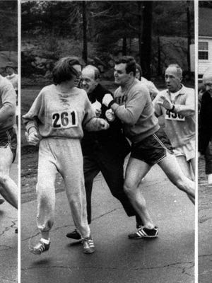 A woman, listed only as K.V. Switzer of Syracuse, found herself about to be thrown out of the normally all-male Boston Marathon when a husky companion, Thomas Miller of Syracuse, threw a block that tossed a race official out of the running instead, April 19, 1967 in Hopkinton, Mass.