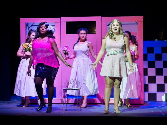 "Libby Scott as Holly, front left, and Kendall Parrett as Julia Sullivan perform during rehearsal of ""The Wedding Singer"" musical at the Pensacola Little Theatre in Pensacola on Tuesday, October 31, 2017."