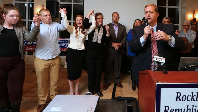 George Hoehmann (right, with microphone) celebrates his 2015 election victory with (from left) his children Ciara, Thomas and Ashleen, and his wife Kathy.
