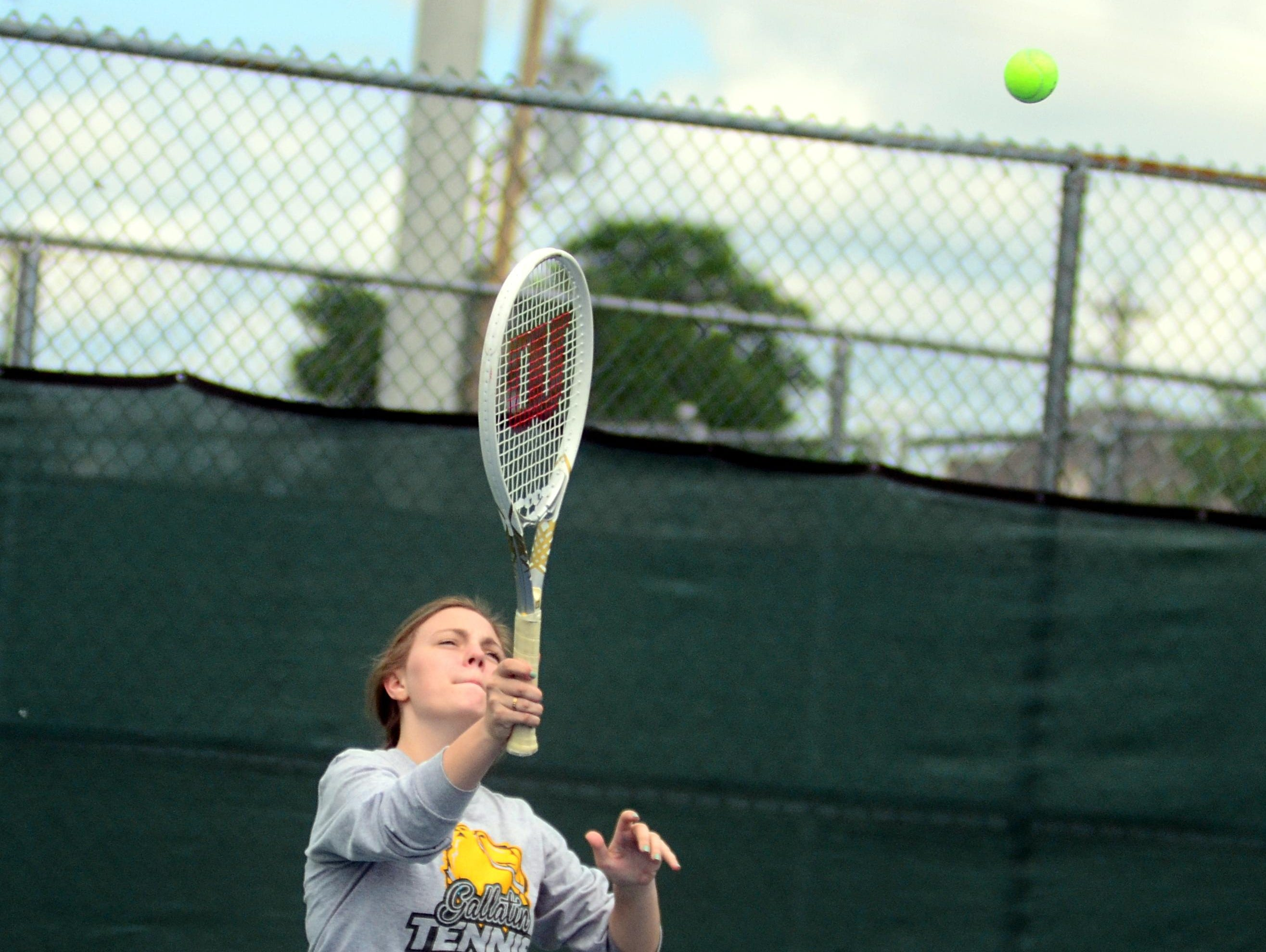 Gallatin High junior Lydia Russell serves during Tuesday's District 9-AAA Individual Tennis Tournament. Russell and classmate Bailey DePasqualie suffered a straight-set loss in the first round.