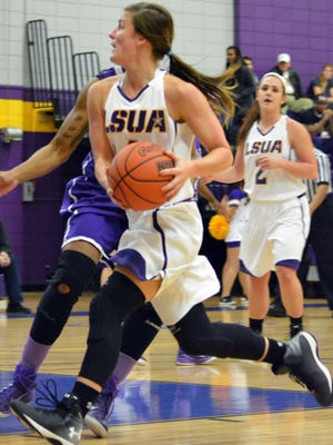 ANI LSUA vs. Wiley LSUA's Reagan Maricle (4, right) goes to the basket against Wiley Friday, Dec. 12, 2014.-Melinda Martinez/mmartinez@thetowntalk.com