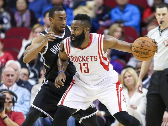 Markel Brown defends against Houston Rockets guard James Harden (13) during a game Feb. 27, 2015 as a member of the Brooklyn Nets. Brown, now a current teammate of Harden's on the Rockets, credits him for helping him getting acclimated to the NBA.