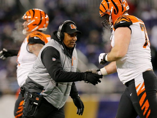 Cincinnati Bengals head coach Marvin Lewis shakes hands with offensive tackle Eric Winston (73) in the second quarter of the NFL Week 17 game between the Baltimore Ravens and the Cincinnati Bengals at M&T Bank Stadium in Baltimore on Sunday, Dec. 31, 2017. At halftime the Bengals led 17-10.