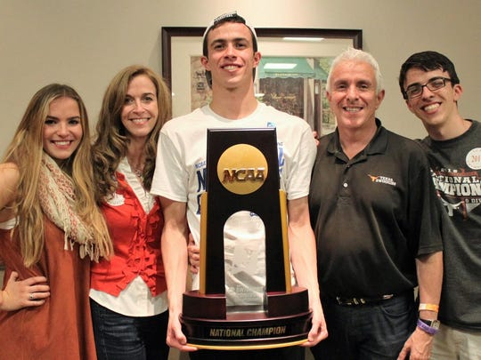 Will Licon, center, with his NCAA championship trophy. His sister, Elizabeth, is at left, next to their mother, Nancy. Will's father, Robert, and his brother, Micheal, are at right.