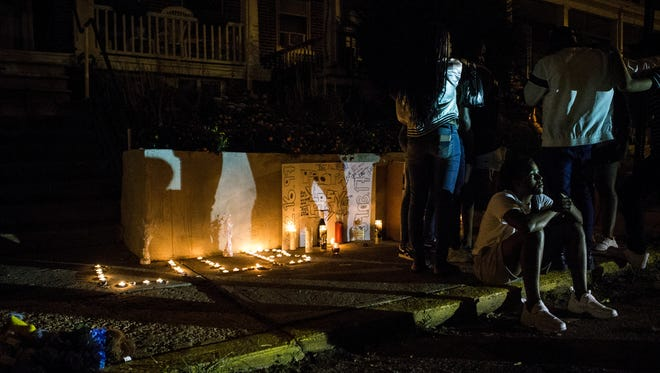 Friends and family members of a 19-year-old man who was shot and killed Sunday night gather at a memorial on W 26th Street in Wilmington Monday evening. The memorial marked a violent weekend in Wilmington with multiple shootings over the holiday.Police have yet to release the name of the victim.
