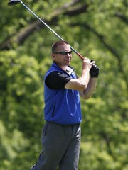 Former Cincinnati Red Chris Sabo watches his tee shot during stroke play at the Metropolitan Amateur Championship in June of 2011.