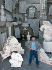 """This 1990 photo provided by the Syracuse University Archives/Syracuse University Libraries shows sculptor Michael MacLeod in his studio in South Kearney. After Donald Trump's Taj Mahal casino in Atlantic City went into bankruptcy the year after it opened, MacLeod, whose studio made giant elephant statues and faux boulders for the complex, recalls, """"We got next to nothing… I took a big hit."""""""