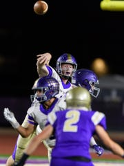 Queen Creek's Devin Larsen (#12) passes in the first quarter of their high school football game against Notre Dame Prep on Friday, Nov. 10, 2017, at Notre Dame Prep High School in Scottsdale, Ariz.