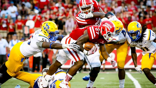 UL running back Jordan Wright gains some tough yards against McNeese State earlier this season.