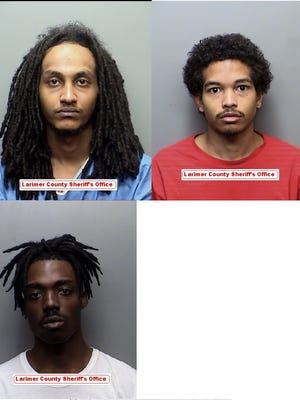 Three men were arrested after they allegedly tried to force a woman out of her car at the Outlets at Loveland.