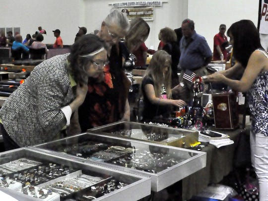 A visitor to the Ruidoso Noon Lions Gun Show eyes the jewelry selection of a participating vendor.