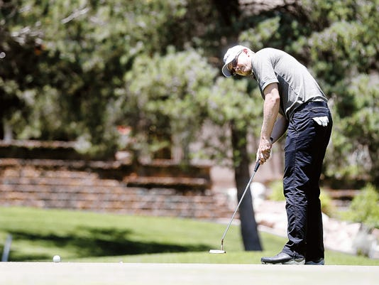 Jim Knous putts on the fourth hole Saturday during the San Juan Open at San Juan Country Club in Farmington. CQ