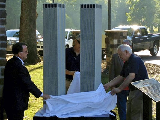 A display that features a replica of New York City's World Trade Center Twin Towers is unveiled Friday at Red Run Park, Washington Township.