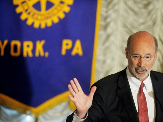 Gov. Tom Wolf addresses education funding at a Rotary Club of York meeting on Wednesday at the Yorktowne Hotel. Wolf, who vetoed the entire budget bill passed by the Republican-led General Assembly, proposes a gas severance tax to help fund education and other services.